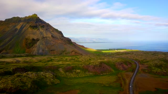 Aerial view of Car driving through a countryside beautiful of Iceland