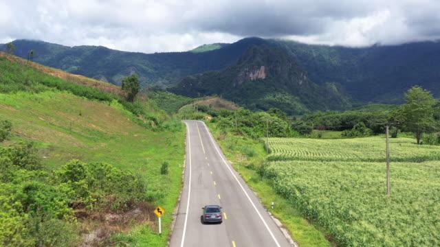 aerial view of car driving to mountain - sydostasien bildbanksvideor och videomaterial från bakom kulisserna