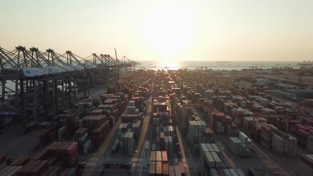 aerial view of cargo container in harbor port in sunset - cargo container stock videos & royalty-free footage