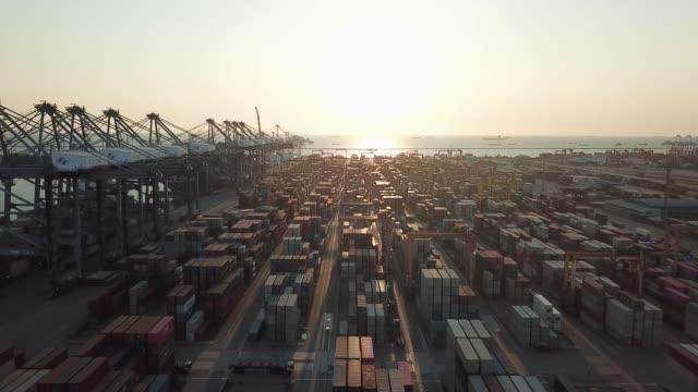 stockvideo's en b-roll-footage met luchtfoto van cargo container in haven haven bij zonsondergang - vrachtcontainer
