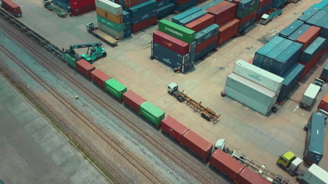 aerial view of cargo containers in railroad yard - darsena video stock e b–roll