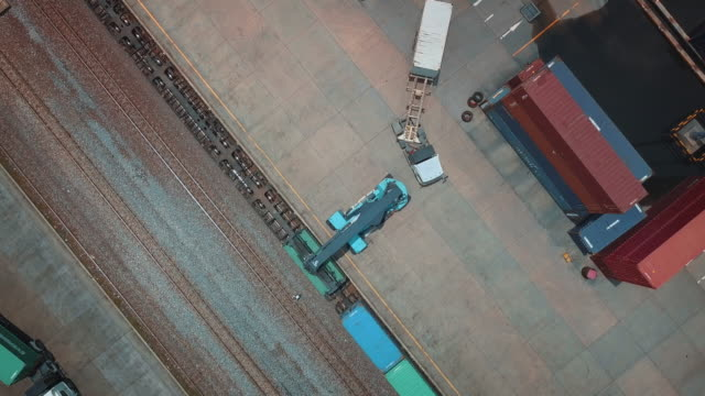 aerial view of cargo containers in railroad yard - cargo container stock videos & royalty-free footage