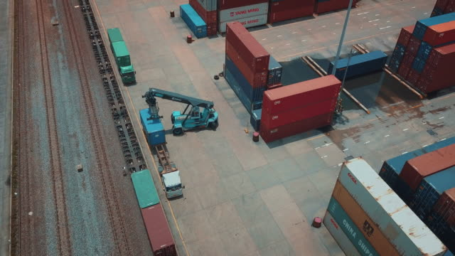 aerial view of cargo containers in railroad yard - diesel fuel stock videos and b-roll footage