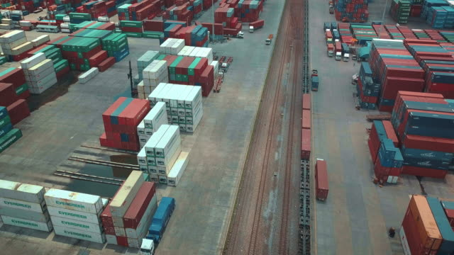 Aerial view of cargo containers in railroad yard