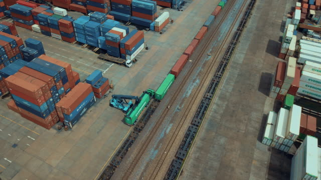 aerial view of cargo containers in railroad yard,time lapse - railway track stock videos & royalty-free footage