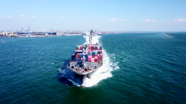aerial view of cargo vessel sailing in the sea - container stock videos & royalty-free footage