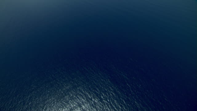 Aerial view of Caribbean Sea with Antigua in the far distance.