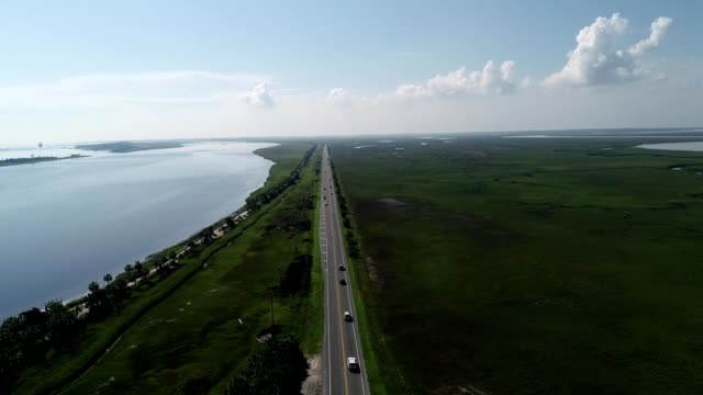 Aerial view of Cars commuting into Tybee Island Georgia