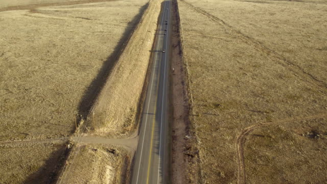 Aerial view of cars driving on remote highway
