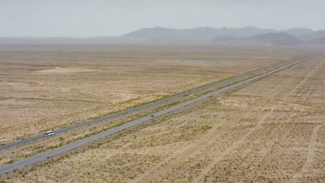 aerial view of cars driving on the gobi desert - horizon stock videos & royalty-free footage