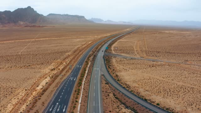 aerial view of cars driving on the gobi desert - country road stock videos & royalty-free footage