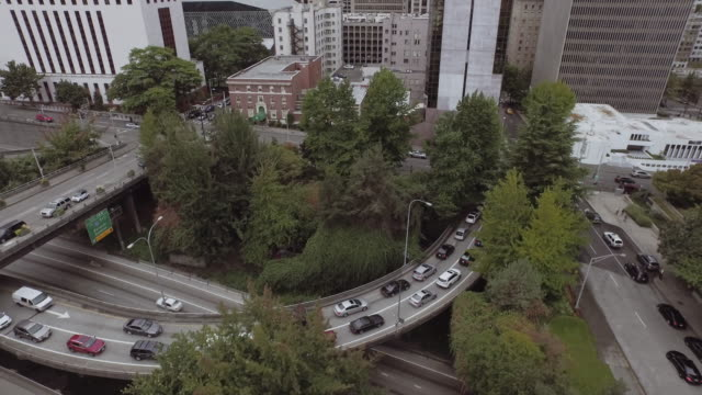aerial view of cars exiting freeway in city - seattle stock videos & royalty-free footage