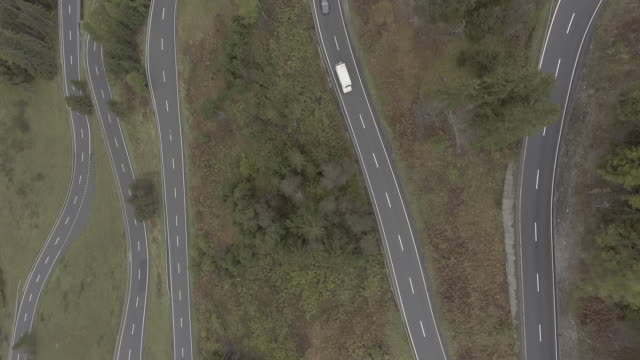 Aerial view of cars moving on winding road amidst trees, Flueela Pass, Switzerland
