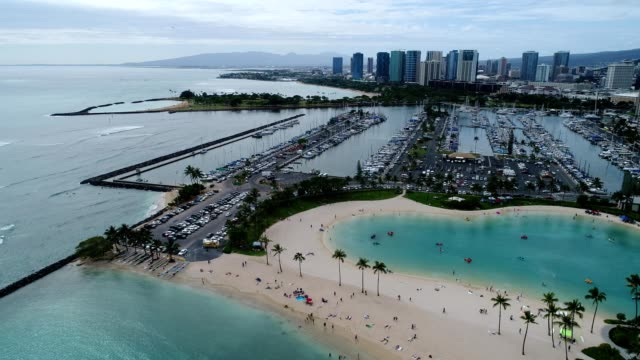 aerial view of cars parked by hotel beaches in waikiki honolulu hawaii - honolulu stock videos and b-roll footage
