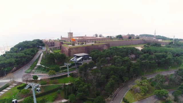 aerial view of castell de montjuic of montjuic hill - overhead cable car stock videos and b-roll footage