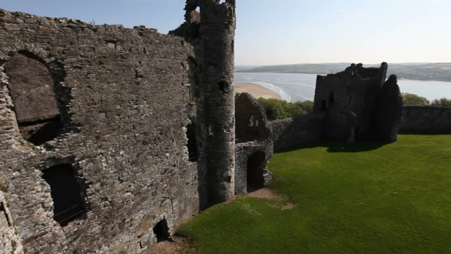 aerial view of castle and beach - wales stock videos & royalty-free footage