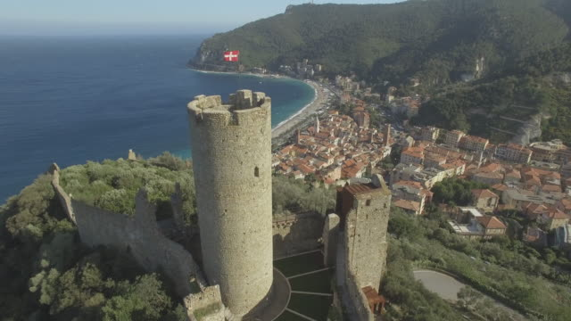 aerial view of castle of noli above ligurian coastal - 城点の映像素材/bロール