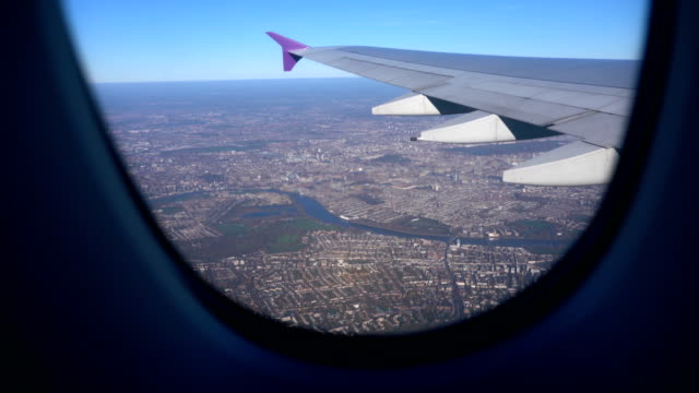 aerial view of central london and the river thames taken from airplane with wing, uk - london bridge england stock videos & royalty-free footage