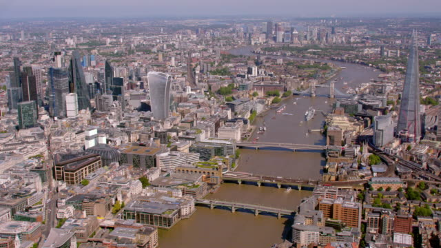 aerial view of central london and the river thames, uk. 4k - east london stock videos and b-roll footage
