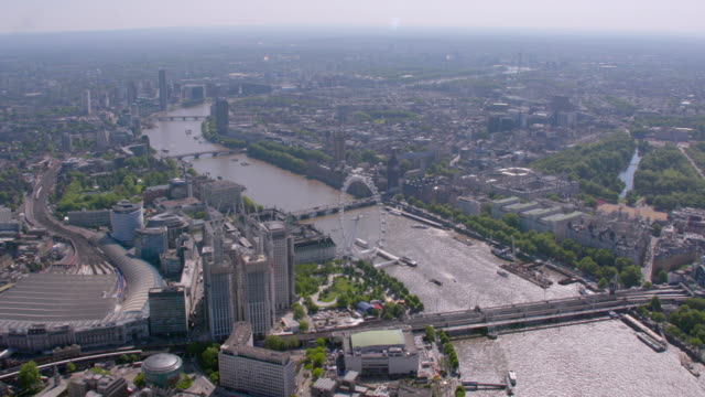 aerial view of central london and the river thames, uk. 4k - millennium wheel stock videos and b-roll footage