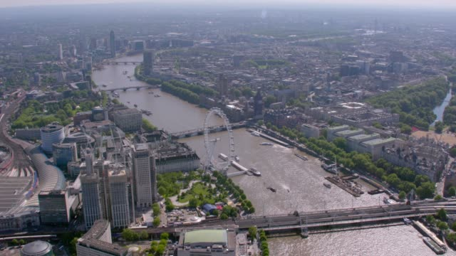 aerial view of central london and the river thames, uk. 4k - millennium wheel stock videos & royalty-free footage