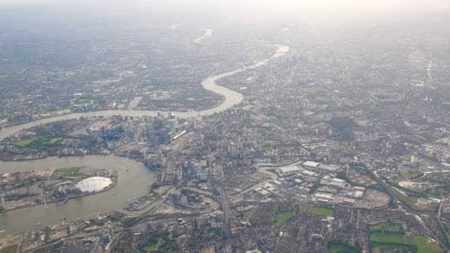 4k aerial view of central london through airplane window - river thames stock videos & royalty-free footage