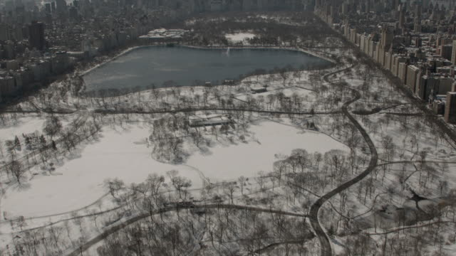 Aerial View Of Central Park Panning Up To The Midtown Skyline New York City