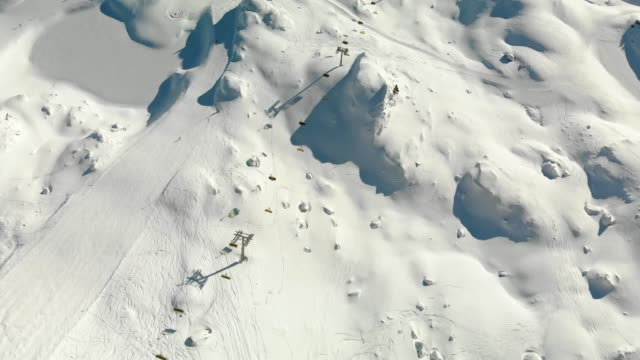aerial view of chairlift at ski resort in the alps - ski flying stock videos and b-roll footage