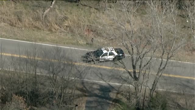 aerial view of charred 2013 chevy tahoe driver aubrey mcclendon was traveling at a high rate of speed when he went left of center and through a... - oklahoma city thunder basketball team stock videos and b-roll footage