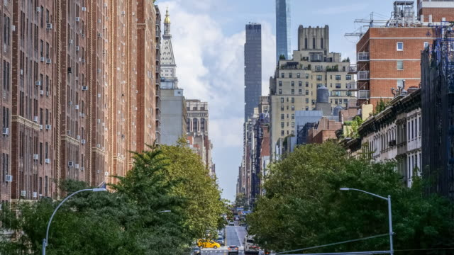aerial view of chelsea neighbourhood street with traffic on street below in new york, manhattan, nyc - chelsea new york stock videos & royalty-free footage