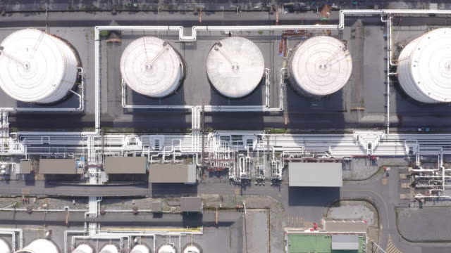 aerial view of chemical industry storage tank and tanker truck in waiting in industrial plant to transfer oil to gas station. - machine valve stock videos & royalty-free footage