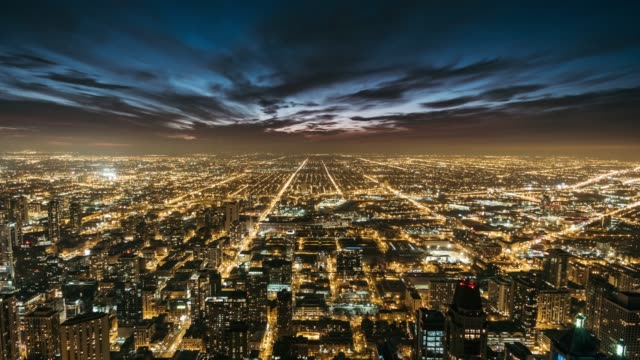 t/l aerial view of chicago skyline at night - street light stock videos & royalty-free footage