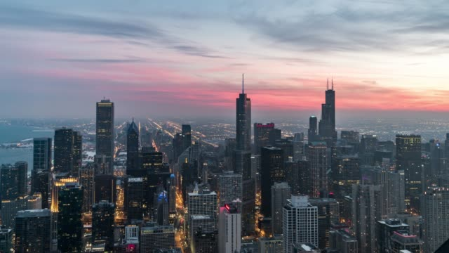 T/L Aerial View of Chicago Skyline, from Sunset to Night / Illinois, US