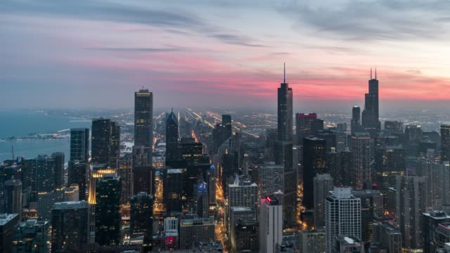 t/l pan aerial view of chicago skyline, from sunset to night - infinity stock videos & royalty-free footage