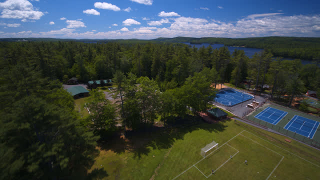 aerial view of children playing soccer and riding horses at summer camp - recreational horse riding stock videos & royalty-free footage
