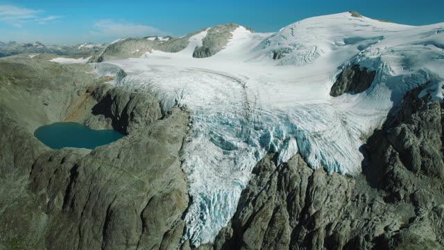 aerial view of chile's queulat glacier - grau stock-videos und b-roll-filmmaterial