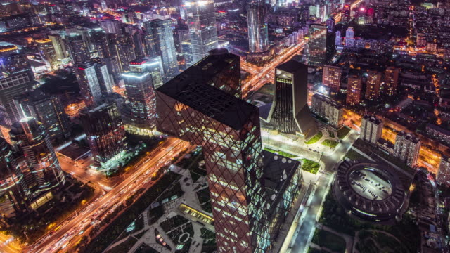 T/L WS HA ZO Aerial View of China Central Television, CCTV Headquarters at Night