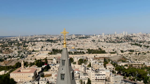 aerial view of christian cross with dome of the rock reveals behind/ jerusalem, israel - jerusalem stock videos & royalty-free footage