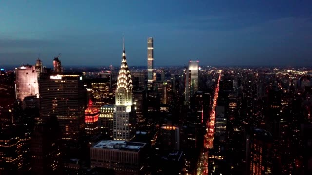 stockvideo's en b-roll-footage met aerial view of chrysler building and streets of new york city during sunset - chrysler