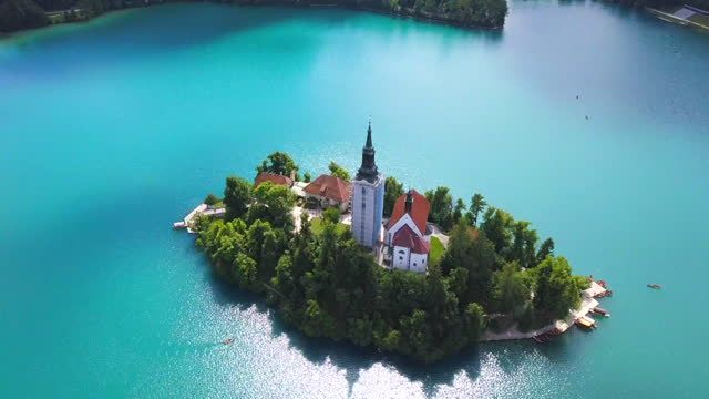 aerial view of church in bled island on lake bled / slovenia - slovenia stock videos & royalty-free footage