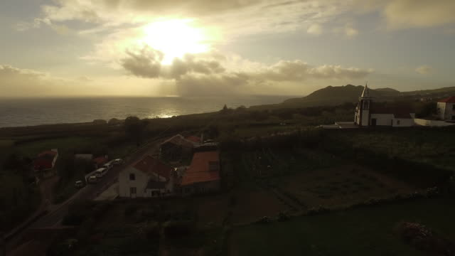 aerial view of church near ocean at sunrise - portuguese culture stock videos & royalty-free footage