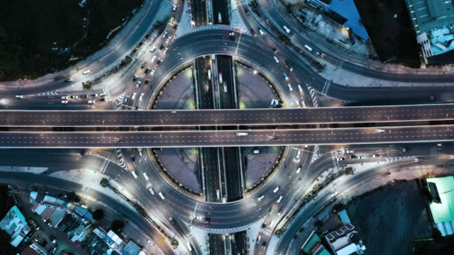 aerial view of circle traffic in the city at night, hyper lapse - roundabout stock videos & royalty-free footage