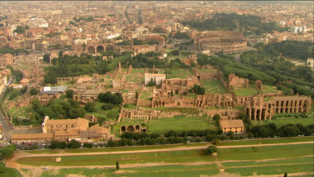 Aerial view of Circus Maximus on Palatine Hill / view of Colosseum and Forum in background / Rome, Italy