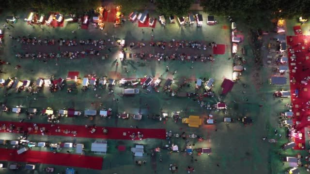 aerial view of citizens and tourists taste local snacks on the snack street on may 25 2020 in xuchang henan province of china - 河南省点の映像素材/bロール