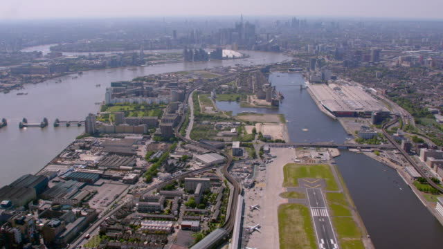 Aerial View of City Airport London and Canary Wharf, UK. 4K