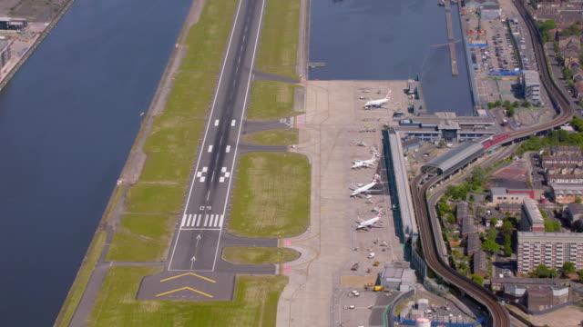 aerial view of city airport london, uk. 4k - runway stock videos & royalty-free footage