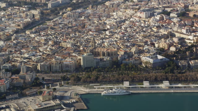 Aerial view of city and port with lighthouse, Malaga, Andalusia, Spain