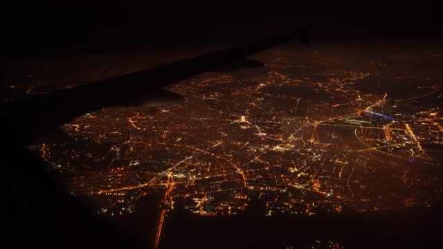 aerial view of city at night when airplane flying on sky - stock video - inquadratura da un aereo video stock e b–roll