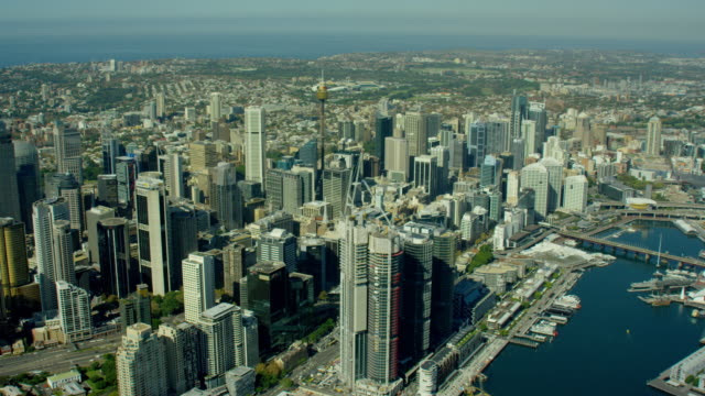 aerial view of city buildings and darling harbour - aerial transport building stock videos & royalty-free footage