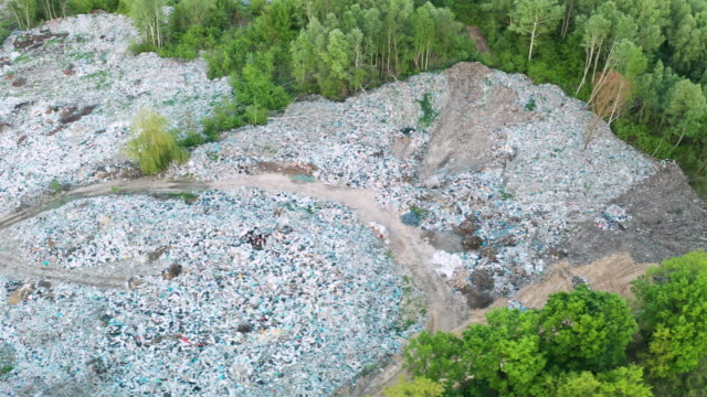 aerial view of city dump or landfill.  pollution concept, top view. - bulldozer stock videos & royalty-free footage
